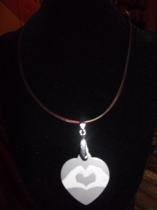 HeartMark Hands Necklace on dog tag