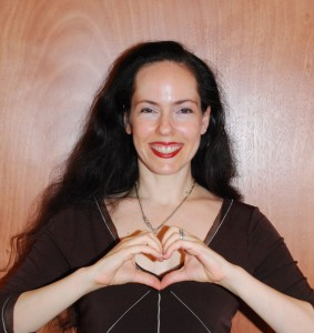 Tali makes a heartmark, a heart with hands