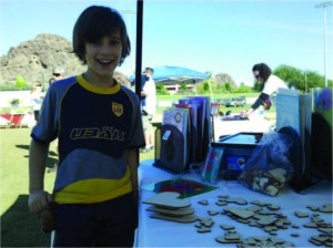 Handsome talented kid discovers talent in 3D design with trademark hearts building a sandwich at Congential Heart Walk where Planet Heart lends a heart hand with a 5 table booth for crafts for children